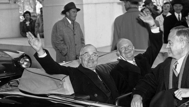 In this Jan. 20, 1953 black-and-white file photo, President Harry Truman, left, and his successor, President-elect Dwight D. Eisenhower, leave the White House in Washington in an open car for inauguration ceremonies.  Sitting in the front is Sen. Styles Bridges of New Hampshire.