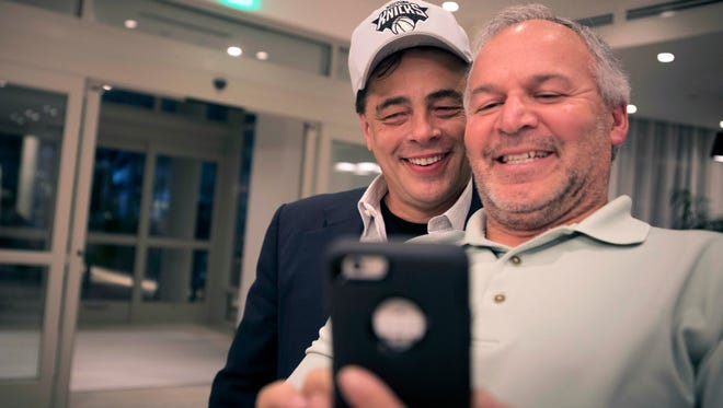 A fan takes a selfie with actor and producer Benicio del Toro in the lobby of a hotel in San Juan, Puerto Rico. He just flew in Sept. 30, 2017, to check on family and offer support to the people of Puerto Rico, where he was born.