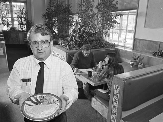 PanTree Restaurant general manager Ron Hummel holds one of the many variations of legendary omelettes the restaurant served, in 1987. The restaurant was located at 327 Abbott Road, East Lansing.