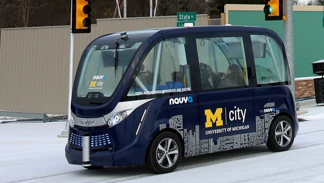 The 15-passenger electric shuttle called the Navya Arma takes members of the media on a tour of the streets of Mcity on the campus of the University of Michigan in Ann Arbor in December. The French firm that builds the electric shuttle plans to open a production plant in Saline this year.