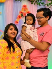 Praveen Sinha with his wife, Shweta, and their niece.