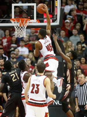 Louisville's Donovan Mitchell throws down a dunk in the first half against FSU. Jan. 20, 2016.