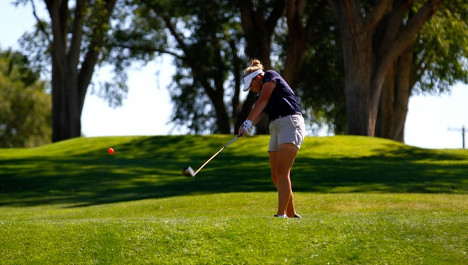 Piedra Vista's Sydney Schumacher tees off during the Chuck Soria Invitational on Monday at Riverview Golf Course in Kirtland.