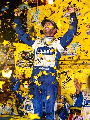 NASCAR Sprint Cup Series driver Jimmie Johnson (48) celebrates winning the NASCAR Sprint Cup championship after the Ford Ecoboost 400 at Homestead-Miami Speedway.