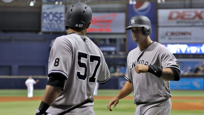 New York Yankees' Gary Sanchez, right, celebrates with on-deck batter Donovan Solano after scoring on an RBI single by Ronald Torreyes off Tampa Bay Rays starting pitcher Alex Cobb during the first inning of a baseball game Wednesday, Sept. 21, 2016, in St. Petersburg, Fla.
