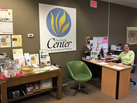 Jill Stiemsma is one of many volunteers who staff the front desk and provide information to new visitors and members at the Fond du Lac Center for Spirituality and Healing.