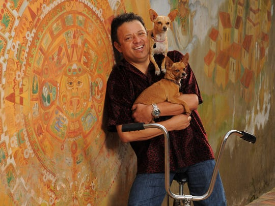 Paul Rodriguez poses with his dogs Chica (top) and
