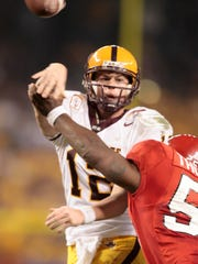 ASU quarterback Rudy Carpenter throws the ball as RDevraun
