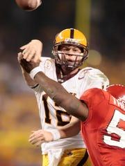 ASU quarterback Rudy Carpenter throws the ball as RDevraun