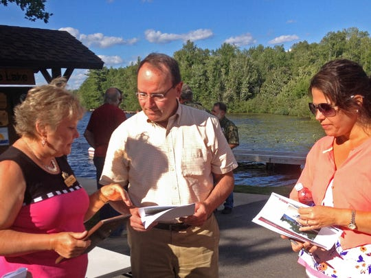 Sen. Tom Tiffany (R-Hazelhurst) at Townline Lake in Oneida County for the dedication of a boat landing with Annie Loechler (left) of the Department of Natural Resources and Sue Harris (right), town clerk of Three Lakes.