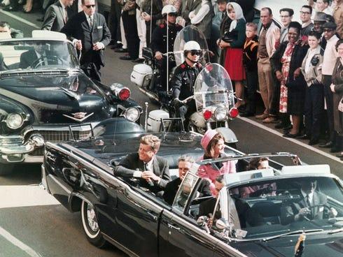 In this Nov. 22, 1963 file photo, President John F. Kennedy's motorcade travels through Dallas.