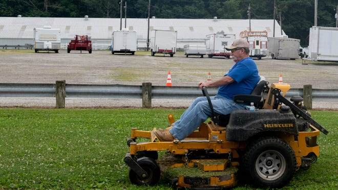 Maintenance crews work on getting the Summit County Fair ready to open tomorrow. The governor's mandate requiring fairs opening July 31 and on to only conduct Junior Fair events will not impact the Summit County Fair.