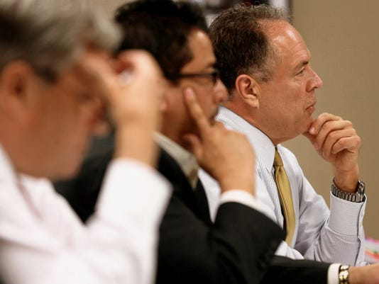 University Medical Center President and CEO Jim Valenti, right, addresses county commissioners Wednesday. Chief Financial Officer Michael Nunez is at center, and Board President Steve DeGroat is at left.