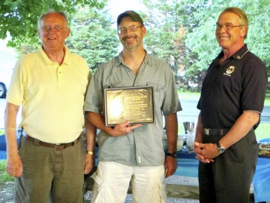 Gettysburg Lion of the Year: Gettysburg Lion Ken VanHoutte, center, is awarded the Gettysburg Lion of the Year for his service to the local club. VanHoutte is flanked on the left by president Tom Kellam and on the right by Lions Zone chairman Dennis Cronin.