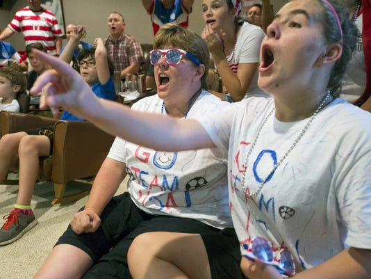 Dorsey Blaine, left, and her daughter Ashley, age 14,  watch the Women's World Cup soccer final in Lower Windsor Township Sunday. The pair recently traveled to Montreal twice to watch games leading up to the game tonight.
