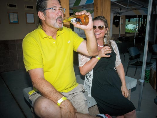 Joe Arrieta and Sarah Ward enjoy a beer at the first Tequila, Tacos & Cerveza Festival held Friday at the New Mexico Farm & Ranch Heritage Museum.