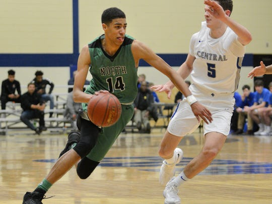 Oshkosh North's Tyrese Haliburton drives past Brookfield