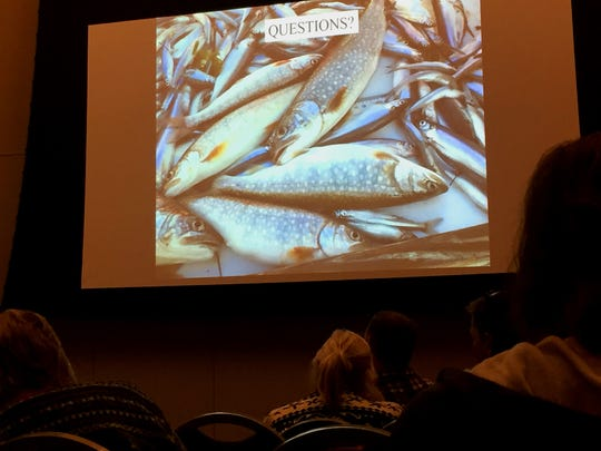 Participants at a research conference on Lake Champlain ponder the health of lake trout Monday at University of Vermont's Davis Center. Photographed Jan. 8, 2017.