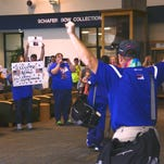 Amie Opie hugs a supporter on Monday at the Great Falls Airport. Opie, a Special Olympics Montana athlete from Butte, returned from the World Games in Los Angeles with a gold medal in the 10K cycling event.
