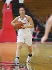 Marist College's Allie Best makes a pass against Fairfield