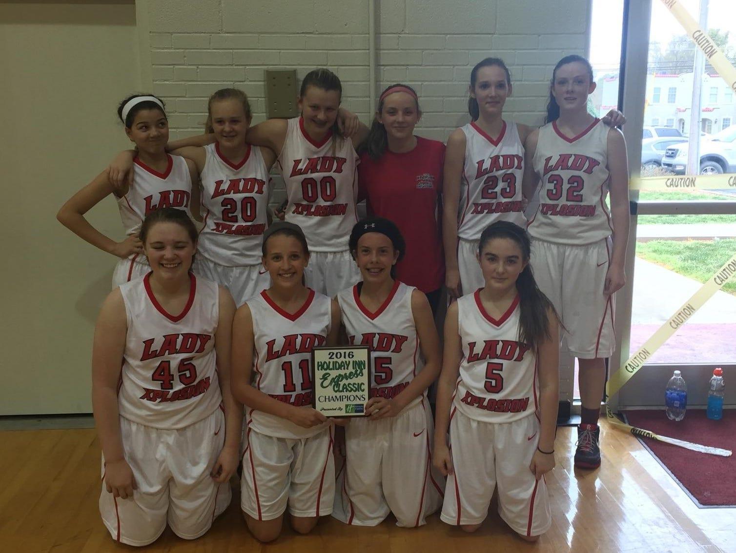 The Lady Xplosion 8th grade basketball team.
