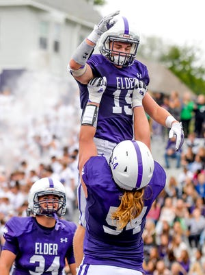 Elder running back Luke Masminster is lifted in the air after scoring a Panther touchdown.