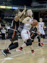 Colonel's Grace Perry (right) spins to the basket against