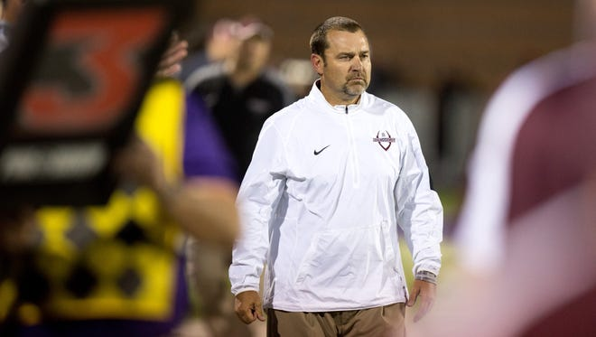 Dowling football \coach Tom Wilson led his team to a state record third straight Class 4A title.