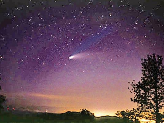 The Hale-Bopp comet in the night sky.