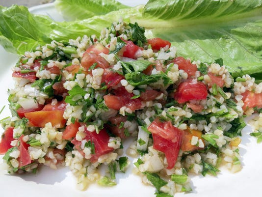 Tabouli begins with bulgur, a whole grain, and parsley tossed in a lemon juice and olive oil dressing. Tomatoes and scallions are optional add-ins that give the salad color and zing.