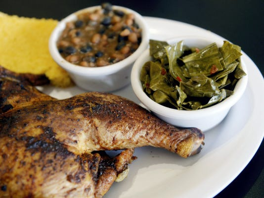A platter of smoked chicken, beans and collard greens, as pictured on Thursday, June 18, 2015, at Never Forgotten BBQ in Springettsbury Township. The restaurant, co-owned by veteran Bill Kohler, participates in numerous community ventures to benefit local veterans. Chris Dunn — Daily Record/Sunday News