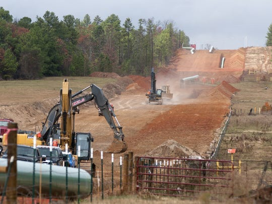 FILE - In this Dec. 3, 2012 file photo, crews work on construction of the TransCanada Keystone XL Pipeline east of Winona, Texas.