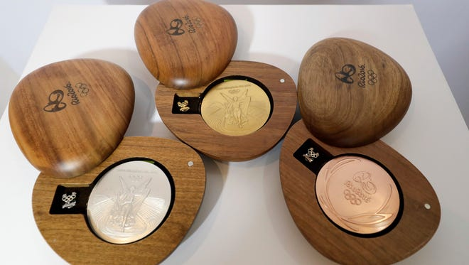The Rio 2016 Olympic medals are displayed at the Olympic Park Wednesday, July 20, 2016, in Rio de Janeiro. There's no such thing as a �gold� medal, not at these upcoming Rio Olympics, and really, not ever. Second-place finishers get silver medals and oddly enough, so do the winners, albeit theirs are plated in a tiny amount of gold. The medals are largely made with recycled materials. (AP Photo/David J. Phillip)