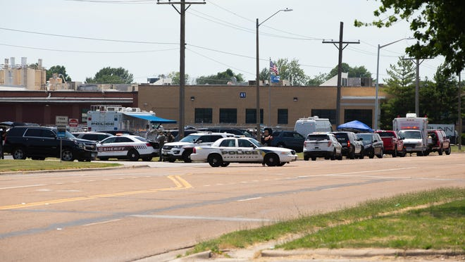 Law enforcement respond Friday to the shooting at the Bunn-O-Matic warehouse on Stevenson Drive.