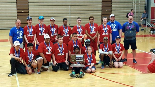 The St. Cloud Area Sluggers pose for a picture after their state adapted softball championship Saturday at Coon Rapids.