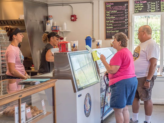 Customers select ice cream at Station 66.