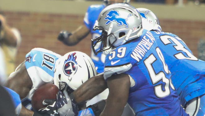 Lions linebacker Tahir Whitehead defends against Titans receiver Andre Johnson as he catches the winning touchdown on fourth down late in the fourth quarter Sunday at Ford Field.
