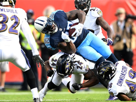 Titans tight end Delanie Walker (82) gets a first down on a catch during the fourth quarter at Nissan Stadium Sunday, Nov. 5, 2017 in Nashville, Tenn.