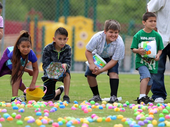 Children wait anxiously to fill their basket with Easter eggs during the 17th annual Easter Fest on Saturday, April 15, 2017.