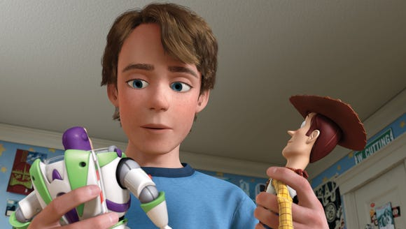 Buzz Lightyear, Andy and Woody in a scene from the