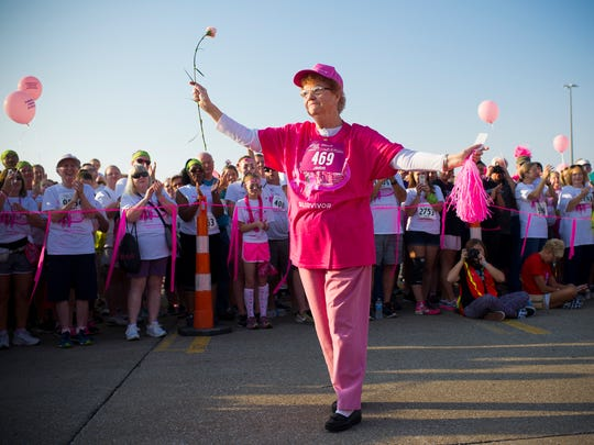 Hundreds of people greet Jean Williams, of Evansville, a 50-year cancer survivor during the survivor recognition program during the 19th annual Susan G. Komen Race for the Cure at Eastland Mall in Evansville, Sunday, Sept. 25, 2016.