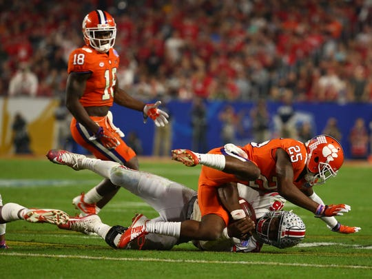 Clemson Tigers cornerback Cordrea Tankersley (25) sacks Ohio State Buckeyes quarterback J.T. Barrett (16) during the third quarter of the College Football Playoff Semifinal game in the PlayStation Fiesta Bowl on Dec. 31, 2016 at University of Phoenix Stadium in Glendale, Arizona.