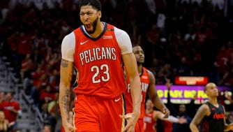 New Orleans Pelicans forward Anthony Davis (23) celebrates during the second half in game three of the first round of the 2018 NBA Playoffs against the Portland Trail Blazers at the Smoothie King Center.