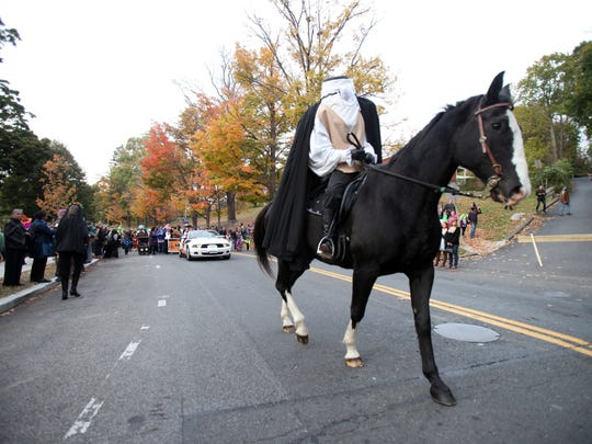 The Headless Horseman leads the way during the Tarrytown