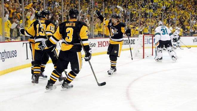 Pittsburgh Penguins right wing Phil Kessel (81) celebrates with teammates after scoring a goal against the San Jose Sharks in the second period of game two of the 2016 Stanley Cup Final at Consol Energy Center.