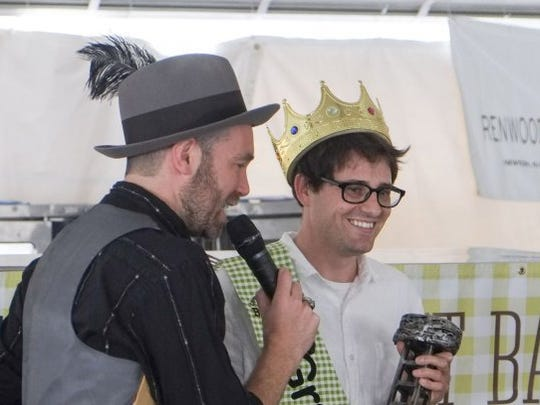 Matt Sandbank of Austin, Tex., right, is winner of the grand prize of the 2016 International Biscuit Festival baking contest in downtown Knoxville. His winning recipe was for an almond caraway biscuit. At left is master of ceremonies Brent Thompson.