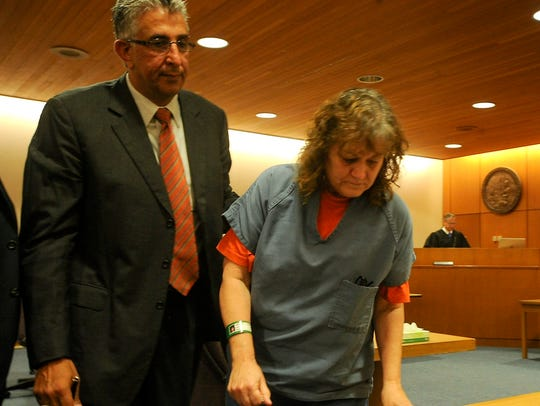 Jane Laut leaves the courtroom with her lawyer Ron