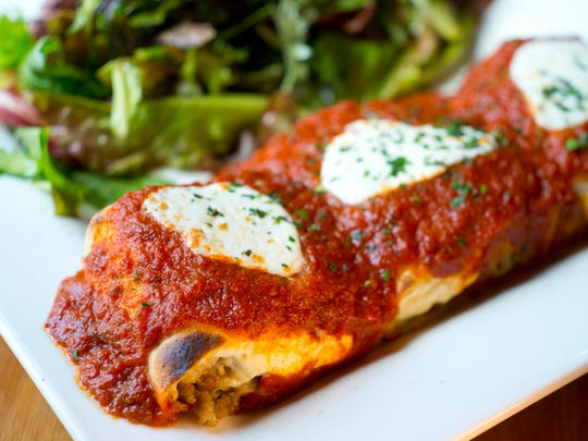 A cannelloni crepe ($9.50) is a Parmesan rolled crepe with ricotta cheese and spinach, topped with tomato sauce and mozzarella cheese.