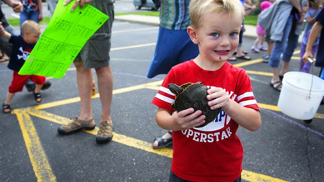Turtle race participant Carsen Middendorf got second place at the Avon Spunktacular Days turtle races on Saturday in the parking lot of Avon Dental. This is Middendorf's fourth year competing in the races.