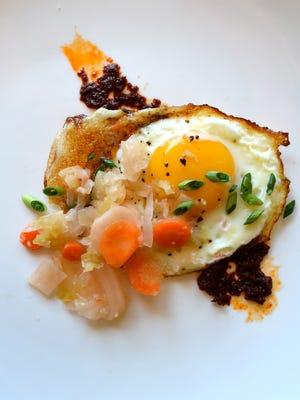 Kramer's Kraut-chi with fried eggs.